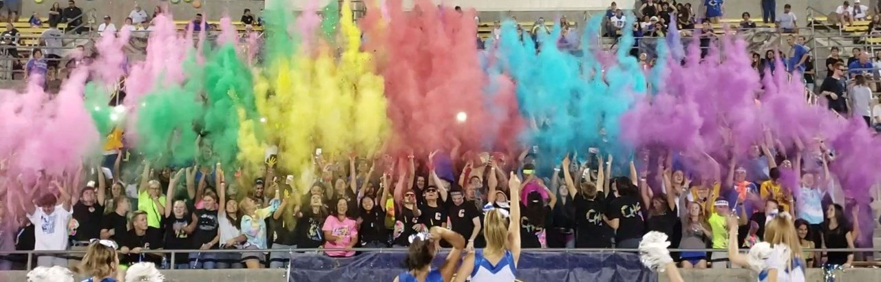 Student section at football game on neon night