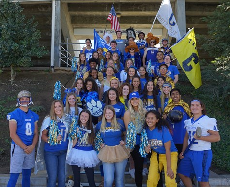 Students in spirit wear at the stadium